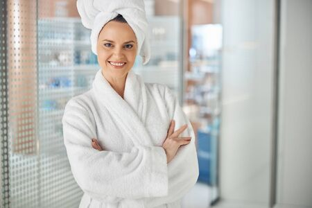 Beautiful lady standing in a spa salon