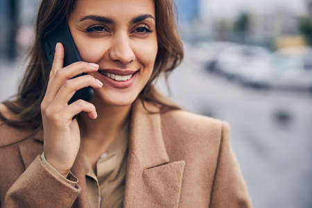 Woman with a happy smile calling on the smartphone
