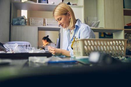 Handcraft process of jewel employee in workroom