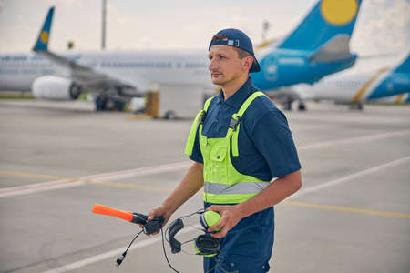 Airport worker gazing fixedly into the distance Imagens
