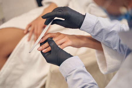 Professional female manicure performed in high quality salon
