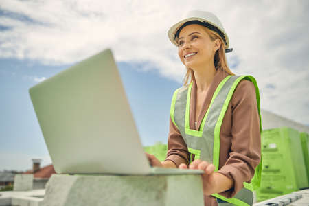 Female constructor sitting at a building site