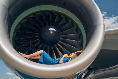 Beautiful Caucasian stewardess lost in her reverie