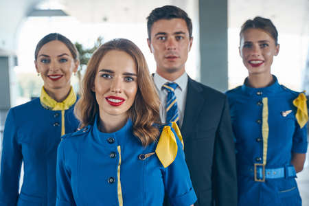 Modern cabin crew posing for the camera