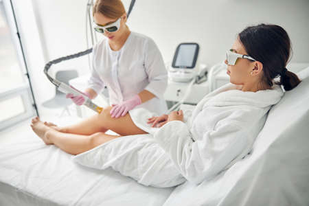 Relaxed young woman undergoing a cosmetic procedure