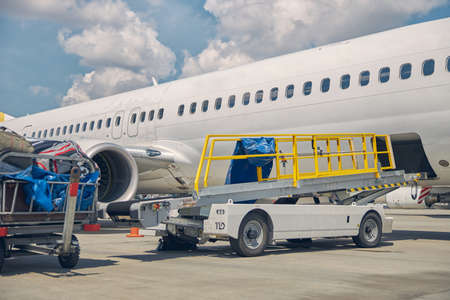 Customer luggage loaded on carts from the landed aircraft