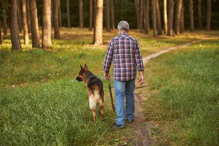 Senior citizen having a walk with his dog Archivio Fotografico