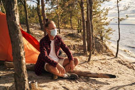Man spending quarantine in open air in wood Archivio Fotografico