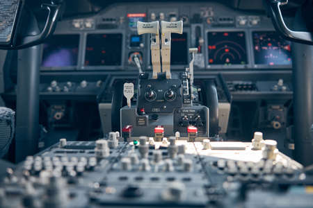 Thrust levers in cockpit or pilot cabin of airplane