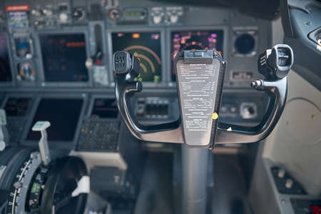Airplane cockpit with control column and flight displays