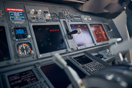 Aircraft flight deck with flight displays, switches and knobs