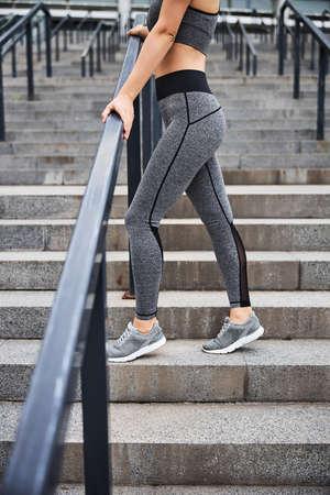 Slim woman wearing sportwear in city centre