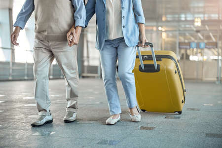 Man and his female spouse with baggage
