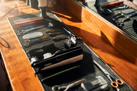 Collection of hairdressing tools on wooden desk