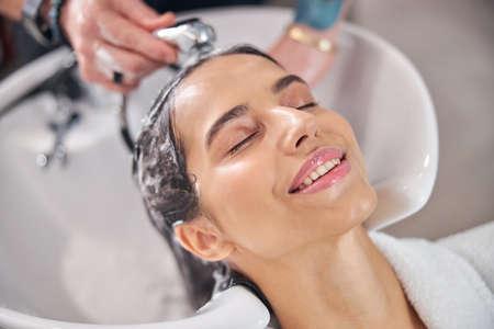 Satisfied face of the client having beauty procedure 版權商用圖片