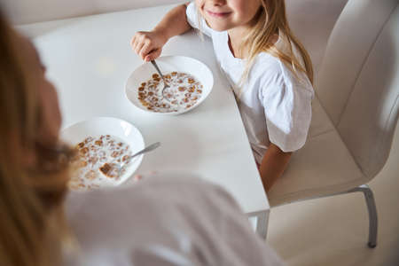 Picture of tasty breakfast of happy lovely family in home kitchen