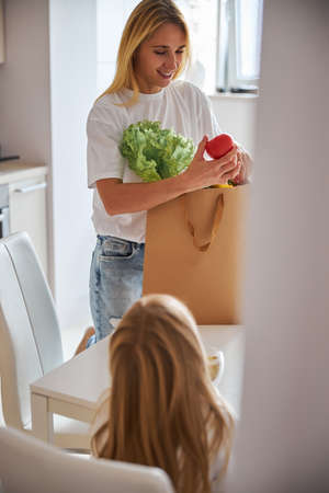 Smiling mother bring eat from supermarket to home