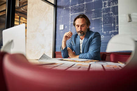 Pensive male worker thinking of possible solutions