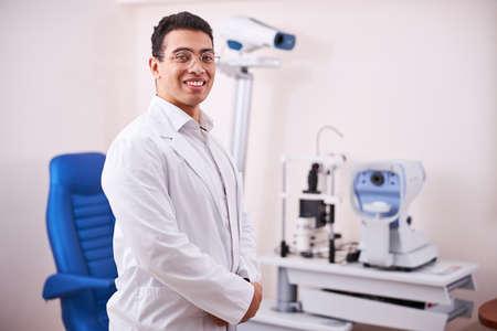 High-spirited dark-haired eye doctor posing for the camera