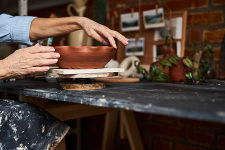 Female potter working in art pottery studio