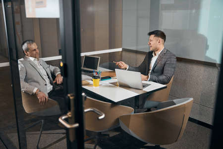 Joyful business partners working together in modern office