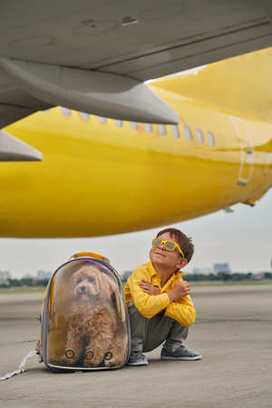 Male child and his pet at the airdrome Reklamní fotografie