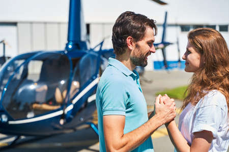 Loving couple looking at each other at heliport