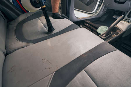 Car interior seats chemical clean with professional high-pressure tool