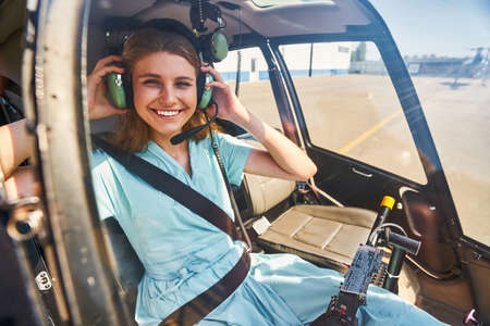 Pleased Caucasian airwoman getting ready for flight