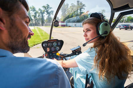 Female student pilot taking aviation lesson with private tutor
