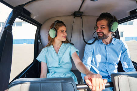 Happy romantic young couple anticipating helicopter flight