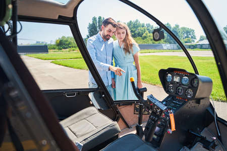 Contented guy demonstrating his private chopper to woman