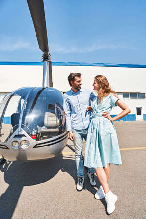Happy romantic couple on helipad at heliport