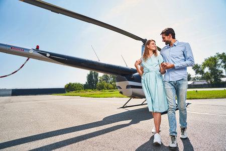 Happy romantic Caucasian couple on landing pad