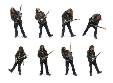 Isolated heavy metal player, playing on guitar