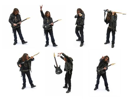 Isolated heavy metal player, poses with guitar