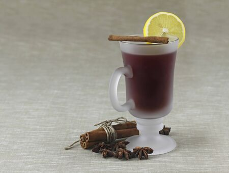 lemon tea with cinnamon on grey background
