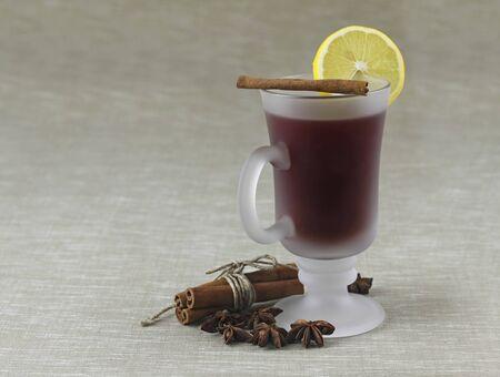 lemon tea with cinnamon on grey background