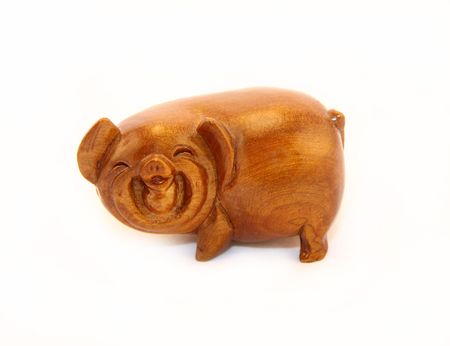 Wooden figure of a pig photo