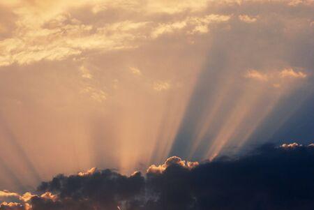 seeping: Sunlight seeping through cloud in sunset