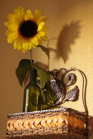 Kitchen wicker vintage shelf with sunflower. photo