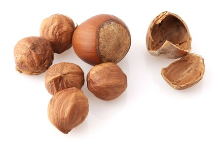 nutshells: Group of hazelnuts, kernels and nutshells close-up on white background. Stock Photo