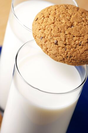 Two glasses of milk and oat cookie close-up. photo