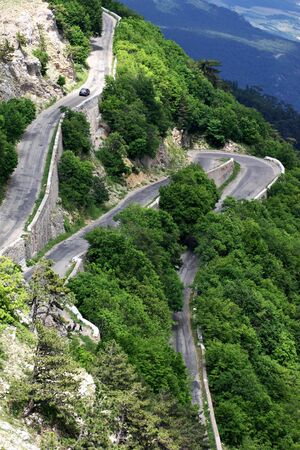 turnover: Mountain road with turnover and car. Stock Photo