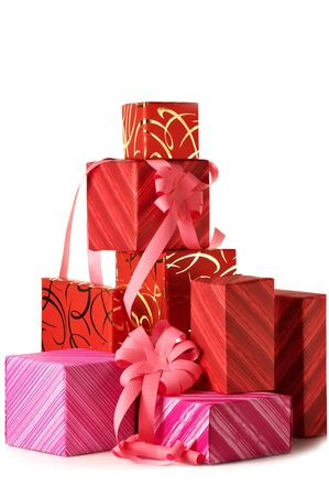 Stack of multicolored gifts on white background. Stock Photo - 5640884