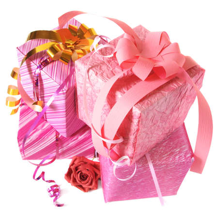 Stack of various pink gifts on white background.