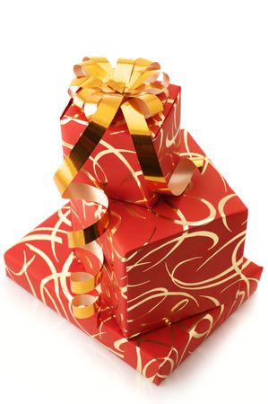 Stack of ornamented red gifts on white background. photo