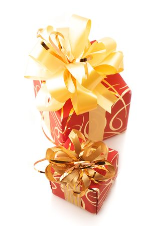 Two red gifts with gold bows isolated on white background. photo