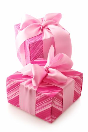 Two pink gifts with satin bows isolated on white background. Stock Photo - 5909197