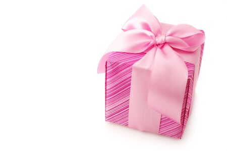 Pink gift with satin bow isolated on white background. photo